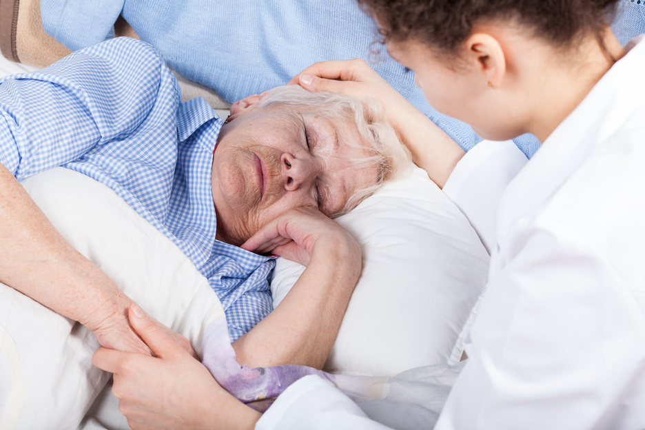 Woman caring about elderly lady