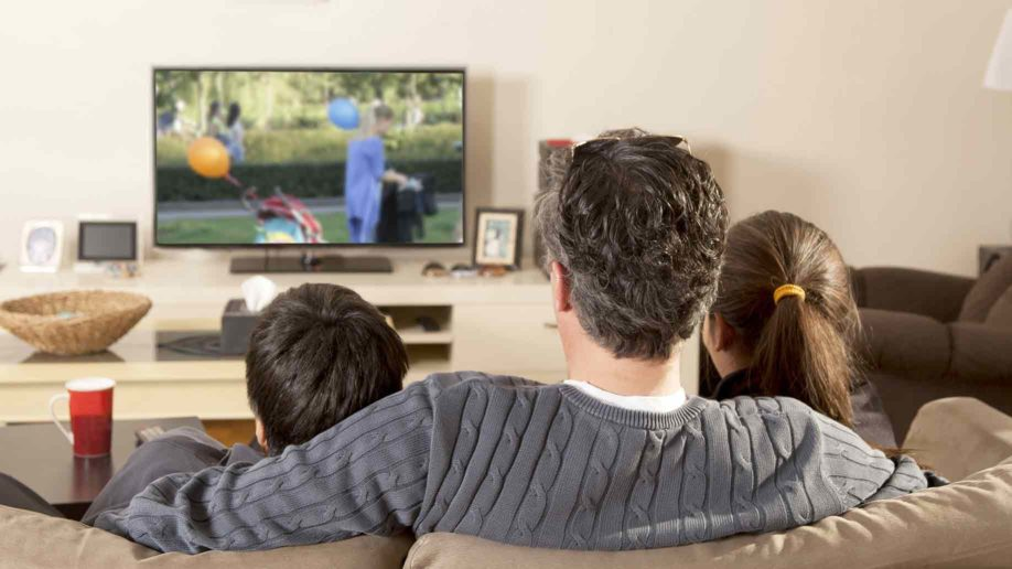 family-watching-tv-isolated-918×516
